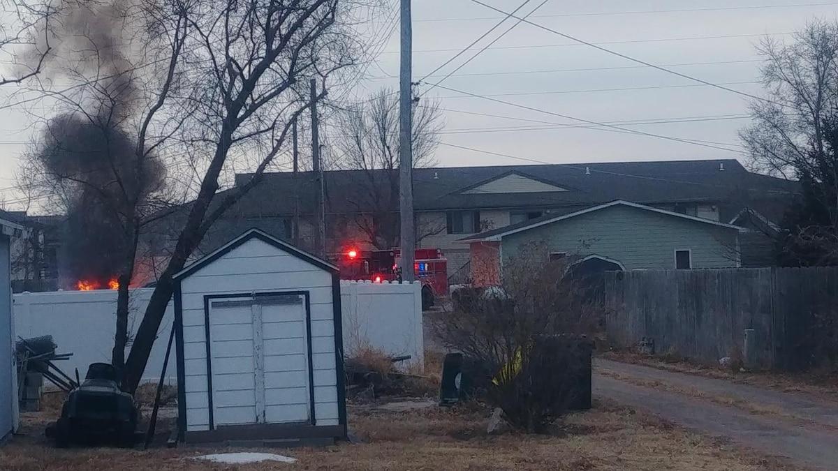 Firefighters battle flames on a frigid North Platte morning to extinguish an engine fire. (SOURCE: Brayden Murdock & Erika Siebring, KNOP-TV)