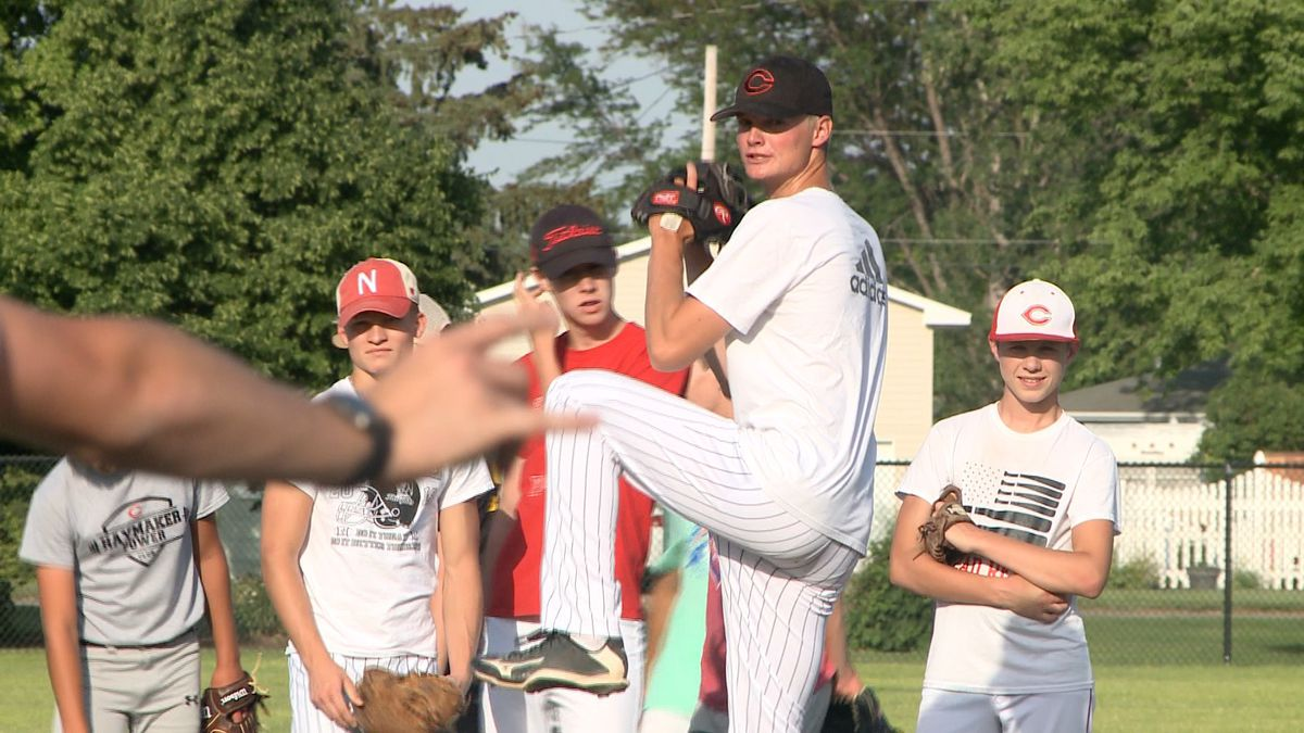 Cozad Reds catcher and pitcher Jacob Engel participates in a drill during team practice. (Credit: Patrick Johnstone/KNOP-TV)
