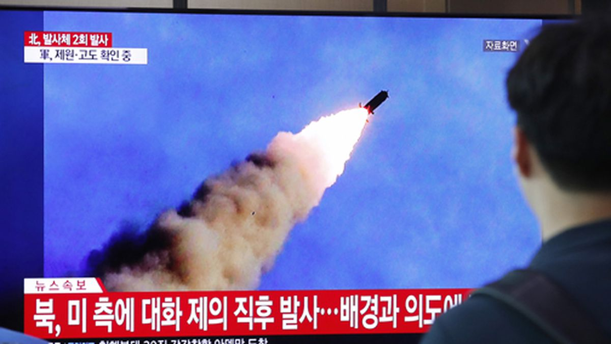 People watch a TV showing a file image of a North Korea's missile launch during a news program at the Seoul Railway Station in Seoul, South Korea, Tuesday, Sept. 10, 2019.
