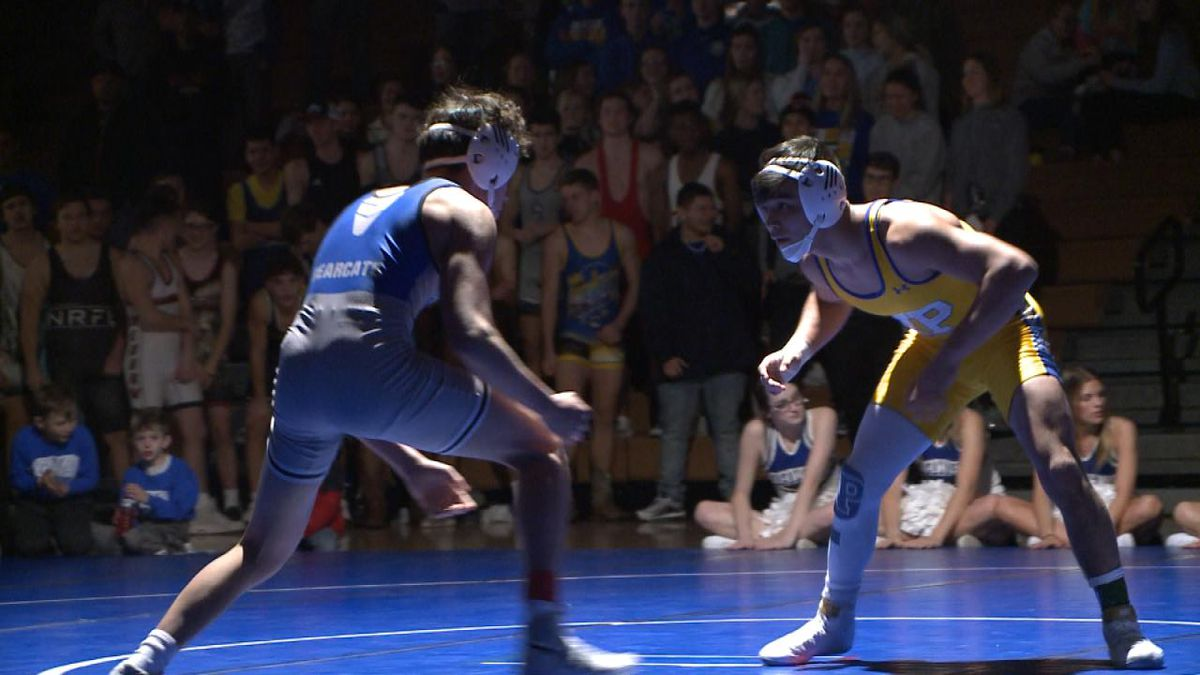 North Platte junior Darian Diaz defeated Kearney's Cisco Rivas 13-3 Thursday to earn his 100th career match win. (Credit: Patrick Johnstone/KNOP-TV)