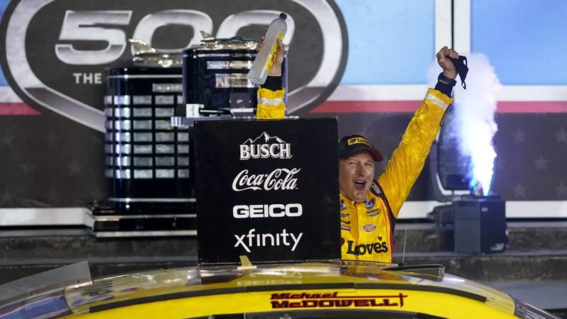 Michael McDowell celebrates after winning the NASCAR Daytona 500 auto race at Daytona...