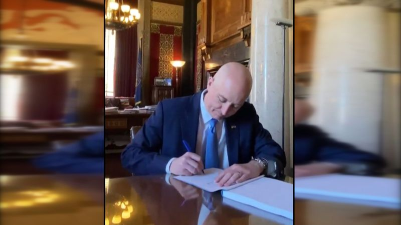 Gov. Pete Ricketts signs the state budget into law