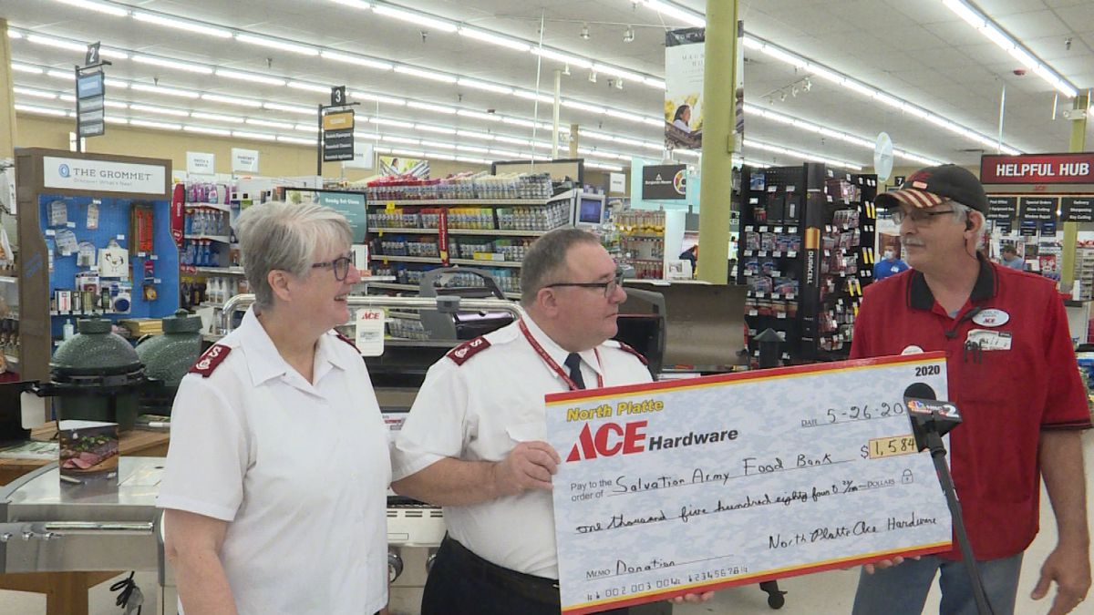 Douglas Wallace of Ace Hardware store presents the check to the Salvation Army. (Credit:Sam...