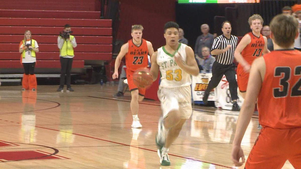 Dolan Branch bringing the ball up the floor for St. Pat's. <br />(Credit:Patrick Johnstone/KNOP-TV)