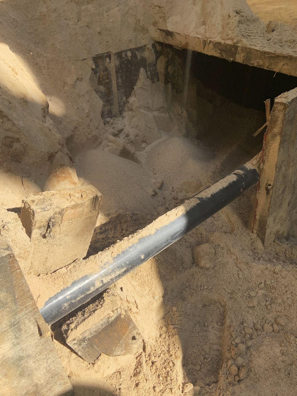 This photo provided by U.S. Immigration and Customs Enforcement shows a section of an incomplete tunnel intended for smuggling, found stretching from Arizona to Mexico.