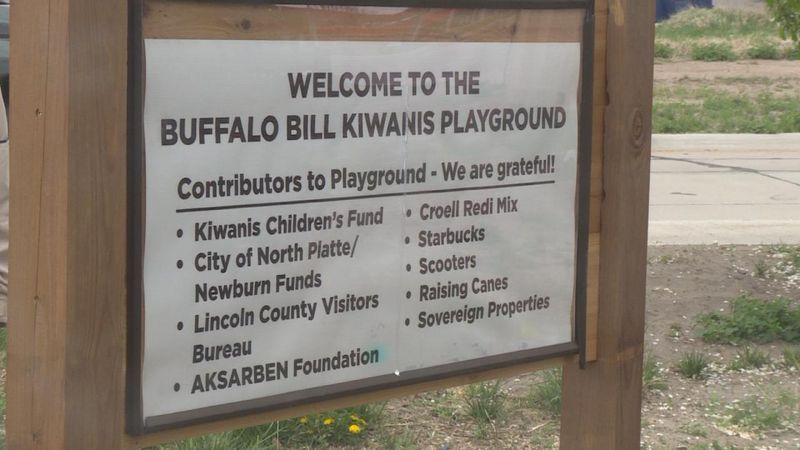 A close up of the new sign in front of the Buffalo Bill Kiwani's playground.