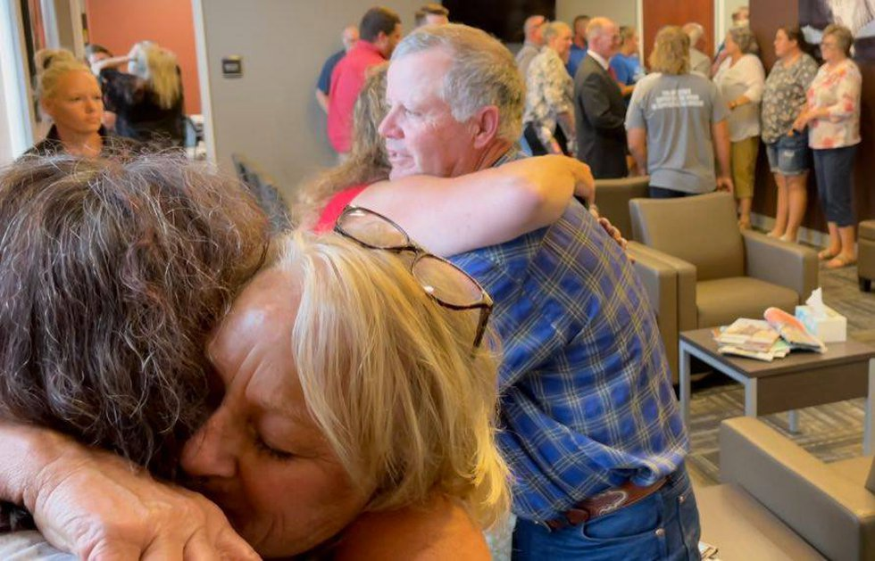Family and friends celebrate after verdict of guilty for Trent Esch with hugging.