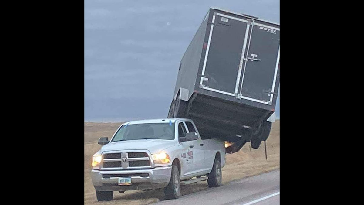 High winds and a lightweight trailer resulted in this unlikely predicament on Highway 385 near the South Dakota border.