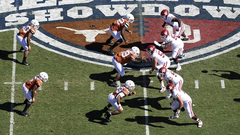 FILE - In this  Oct. 12, 2019, file photo, Oklahoma, right, runs a play against Texas in the...