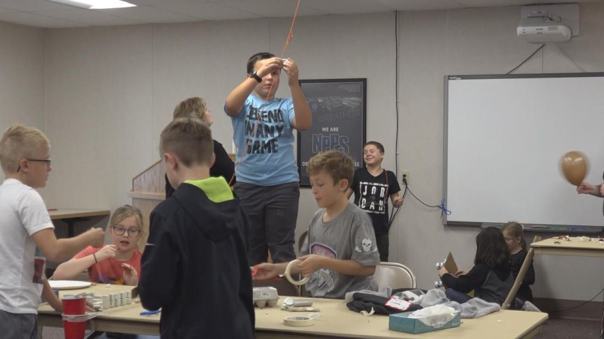 Kids work together to create Rube Goldberg projects. SOURCE: Kaylie Crowe KNOP-TV