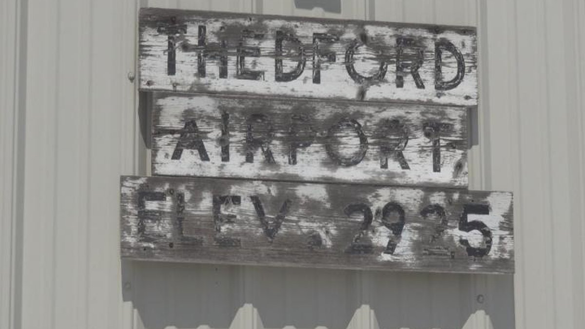 The old Thedford Airport sign on the lobby and hanger.