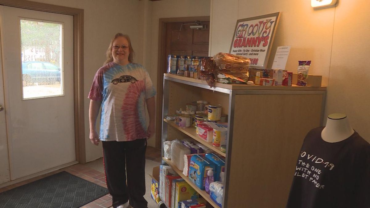 Groovy Granny's owner, Michelle Whips, stands next to the donation cart she had put out which has now been filled by the community three times. (SOURCE: Kaylie Crowe KNOP-TV)