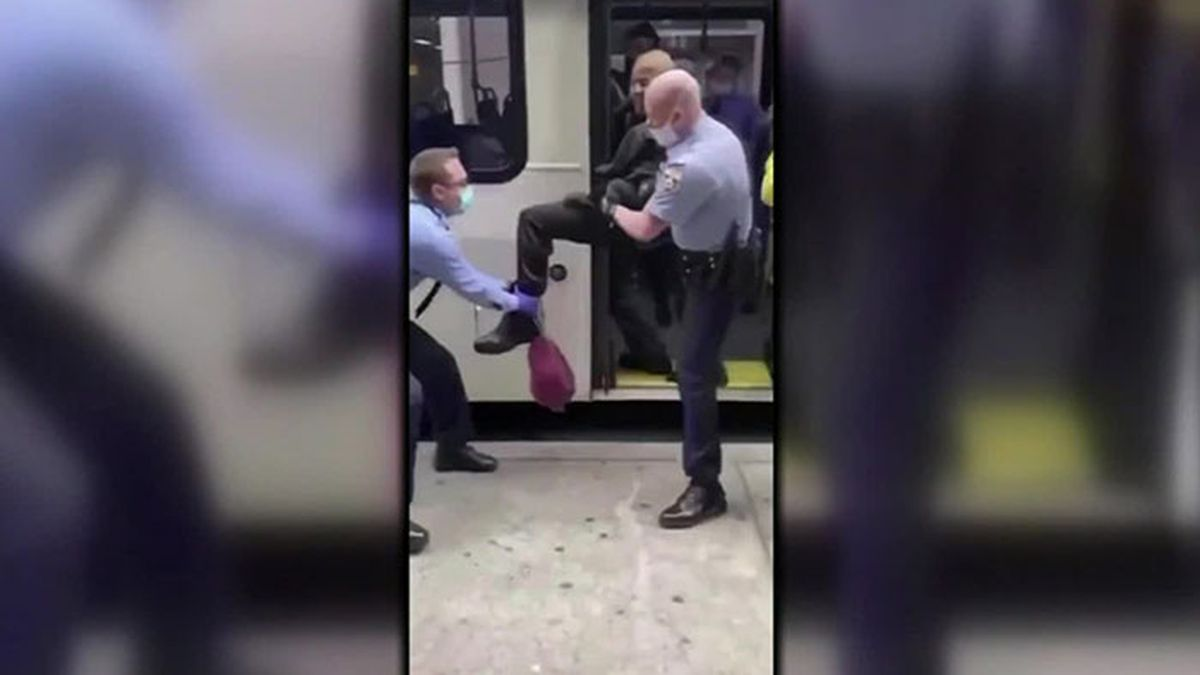 Video footage captures Philadelphia police physically dragging a man from a bus as he resists...