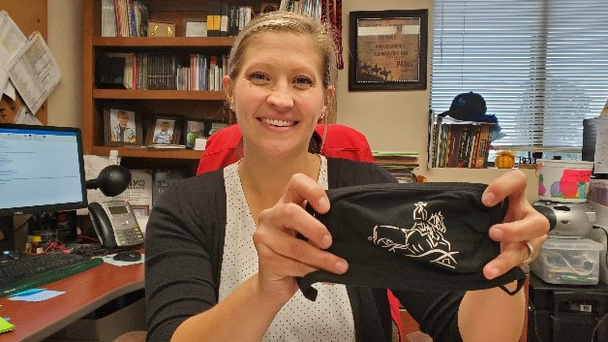 Animal Science Professor and Ranch Horse Team Coach Jo Hergenreder displays her mask of horse...