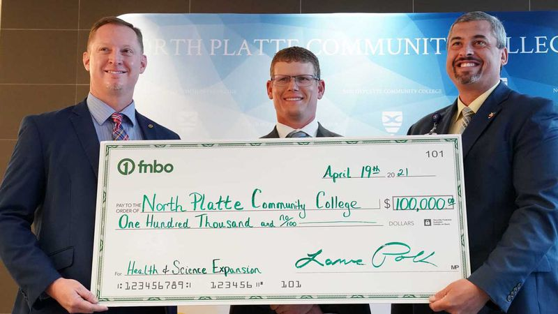 Pictured left to right: First National Bank of Omaha Vice President of Commercial and...