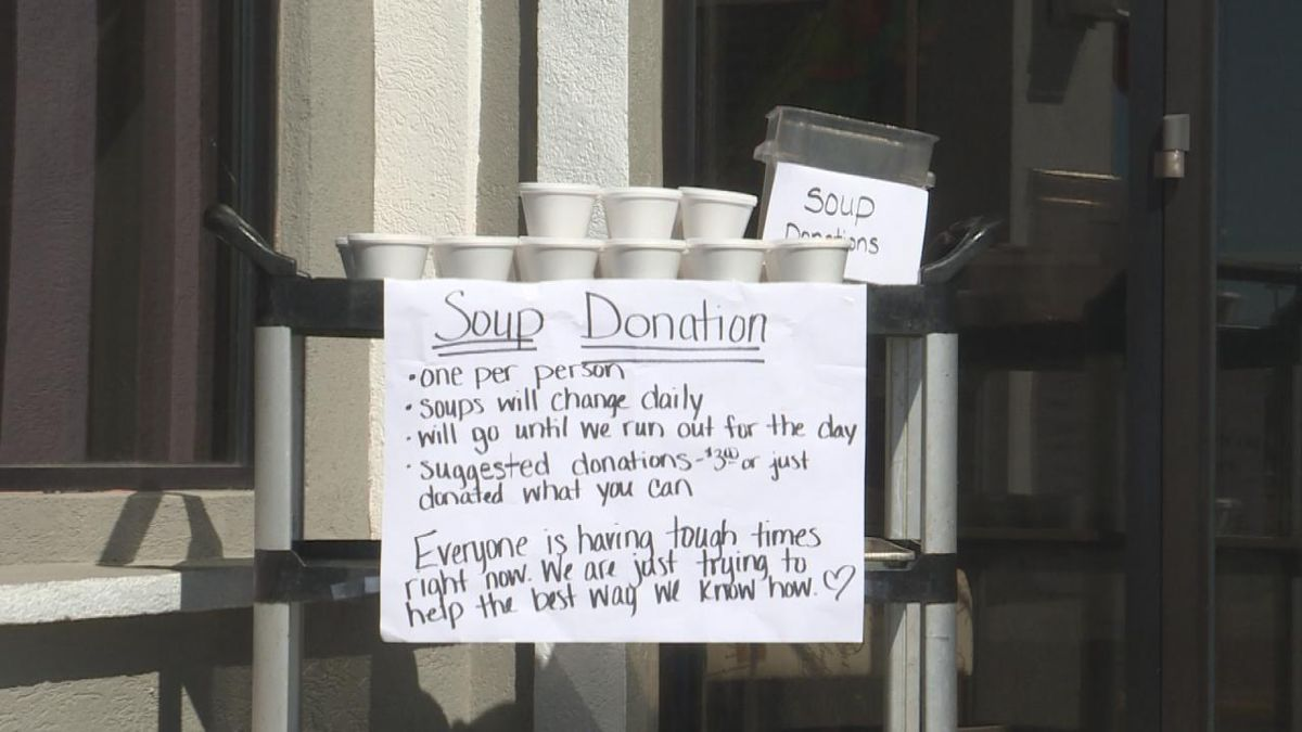 Canteen puts up signs and tables of soup outside their building to show the community they care. (SOURCE: Kaylie Crowe KNOP-TV)
