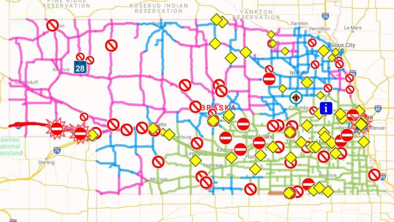 Red lines mean the road is closed. Pink lines means the road is completely covered by snow....