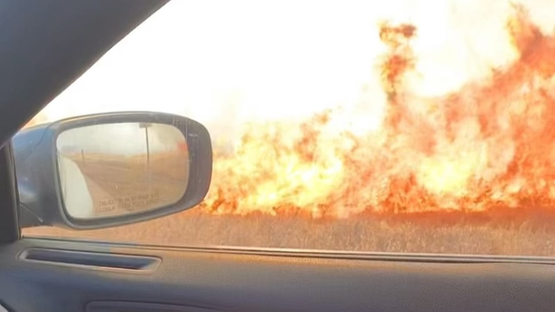 Crews are working to contain a large grass fire along Interstate 80 near Gothenburg.