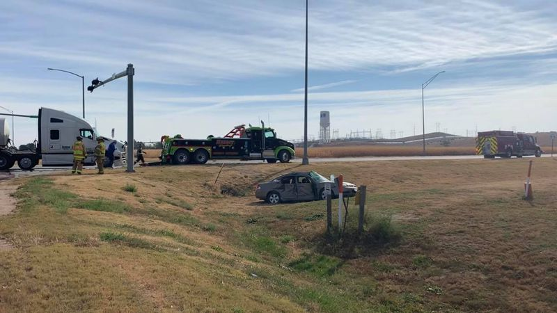 Tanker and passenger car collide at State Farm and Highway 83 intersection.
