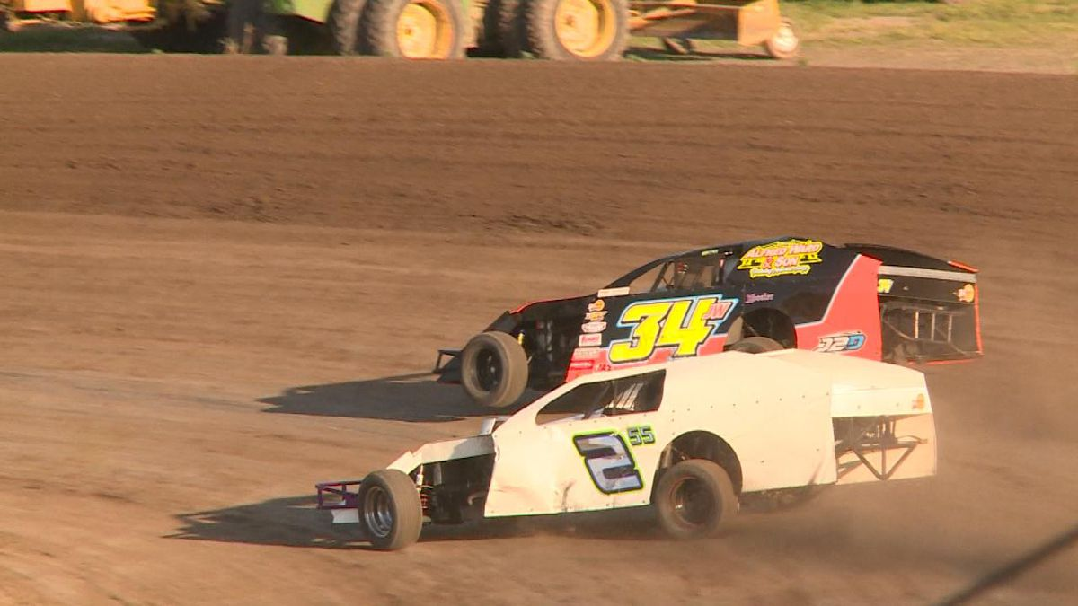 Cole Hodges (34JW) of Ogallala, and Zach Shultz (255) of North Platte race in the Modified Stock King of the Hill at Lincoln County Raceway Friday night (Credit: Patrick Johnstone)