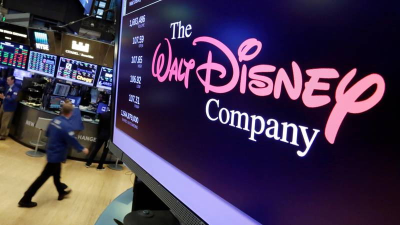 FILE - In this Aug. 8, 2017, file photo, The Walt Disney Co. logo appears on a screen above the...