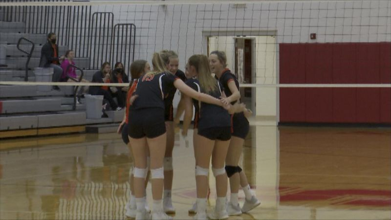 Chase County volleyball huddles up during the match.