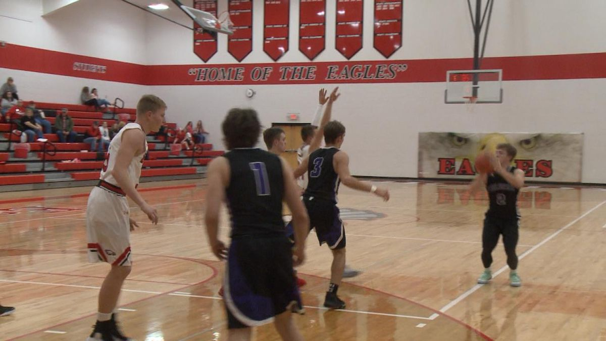 Pierce Utterback shoots a three pointer in Friday nights win over Brady. (Credit: Sam Pirozzi/KNOP-TV)