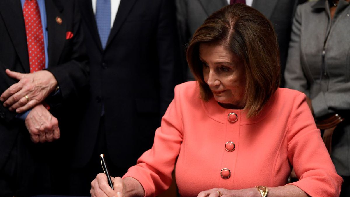 House Speaker Nancy Pelosi of Calif., signs the resolution to transmit the two articles of impeachment against President Donald Trump to the Senate for trial on Capitol Hill in Washington, Wednesday, Jan. 15, 2020. The two articles of impeachment against Pres. Trump are for abuse of power and obstruction of Congress. | Source: AP Photo / Susan Walsh