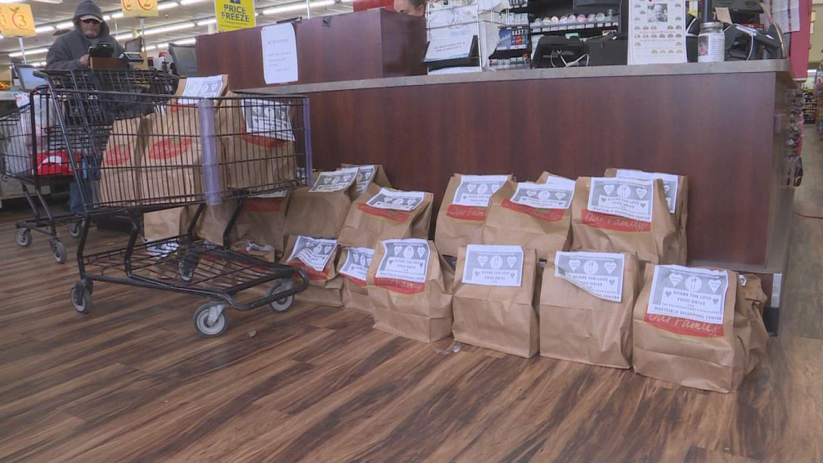 Gary's Superfoods at Westfield collects bags of food for the Salvation Army. (Source: Jace Barraclough/KNOP)