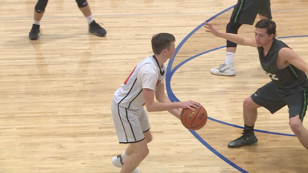 Jack Meyer of Maxwell gets guarded by Wacey Flack of Maywood-Hayes Center on Tuesday night.