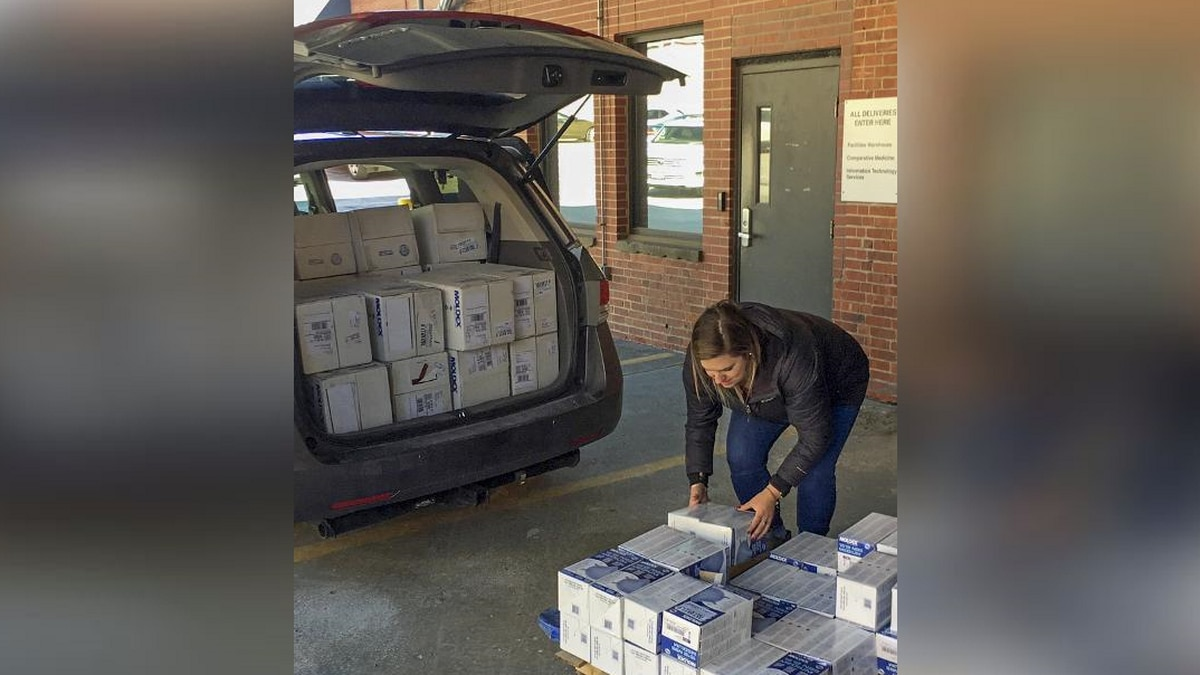 A Nebraska Medicine employee unloads Union Pacific's donation of more than 6,500 N95 masks from a UP vehicle. (Source: Union Pacific)