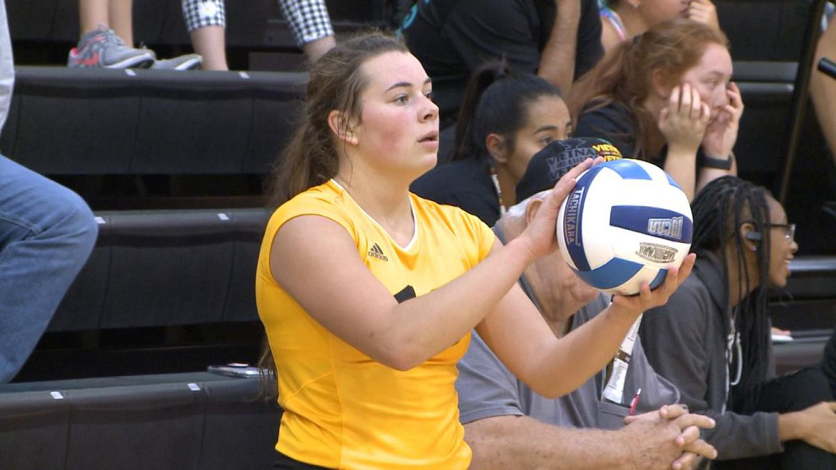 Gabby Menghini prepares for a serve in the NPCC win over Hesston College Friday (Credit: Patrick Johnstone/KNOP-TV)