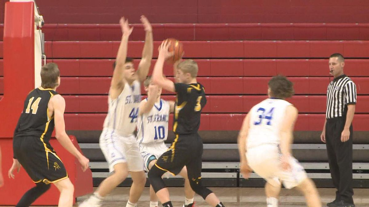 Clayton Moore comes down with an offensive rebound for Mullen.<br />(Credit:Patrick Johnstone/KNOP-TV)