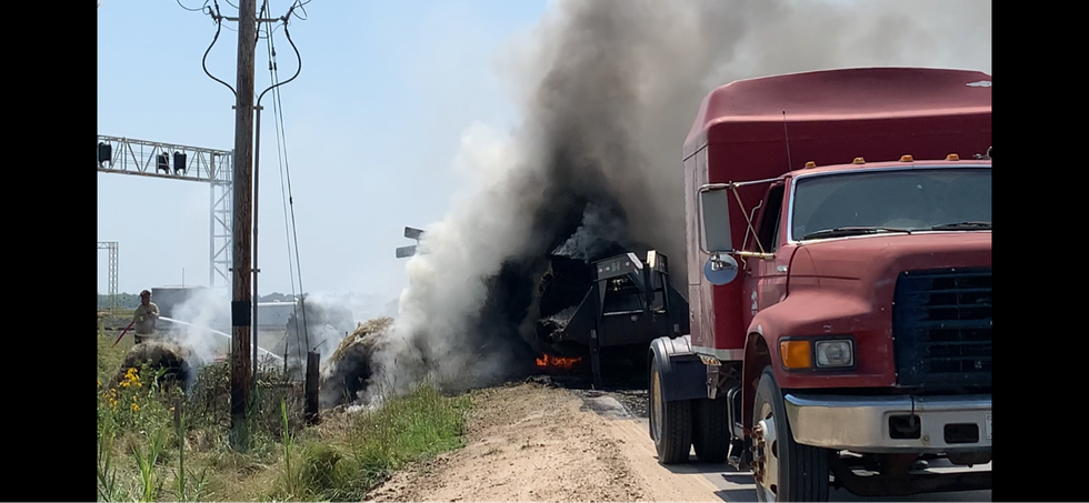 A semi-truck pulling a trailer filled with 18 hay bales caught on fire Thursday afternoon.
