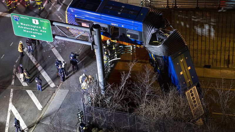 A bus in New York City which careened off a road in the Bronx neighborhood of New York is left...