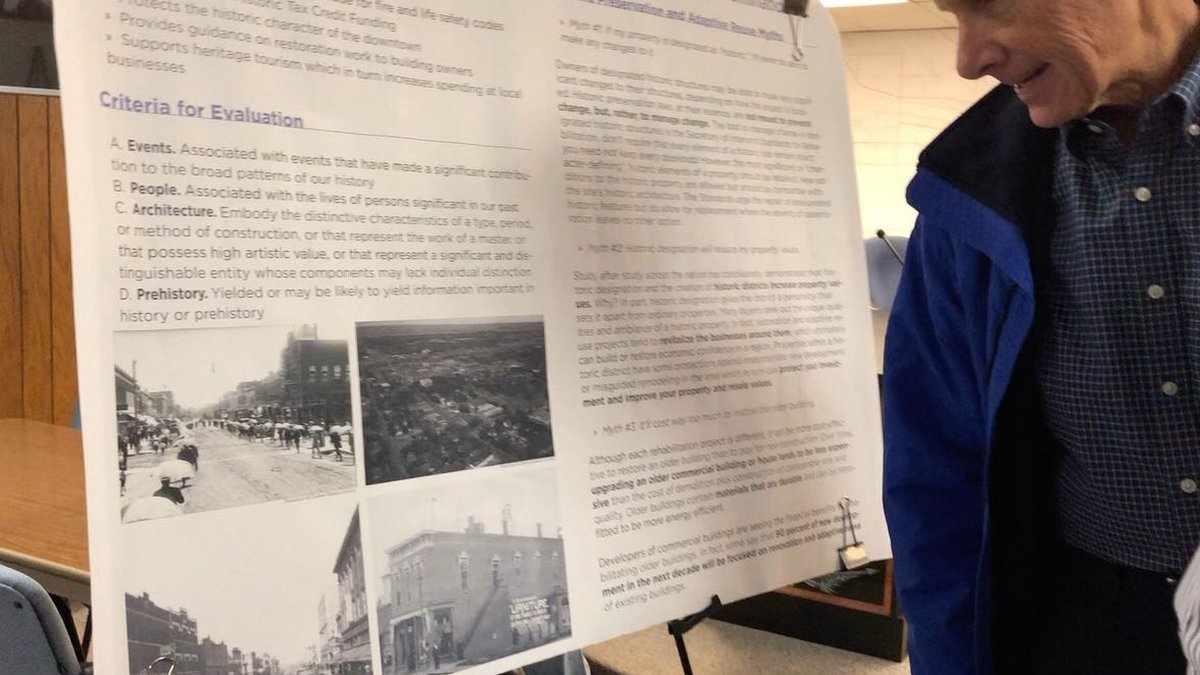 Community members look at historical displays of days gone by at an open house hosted by the...