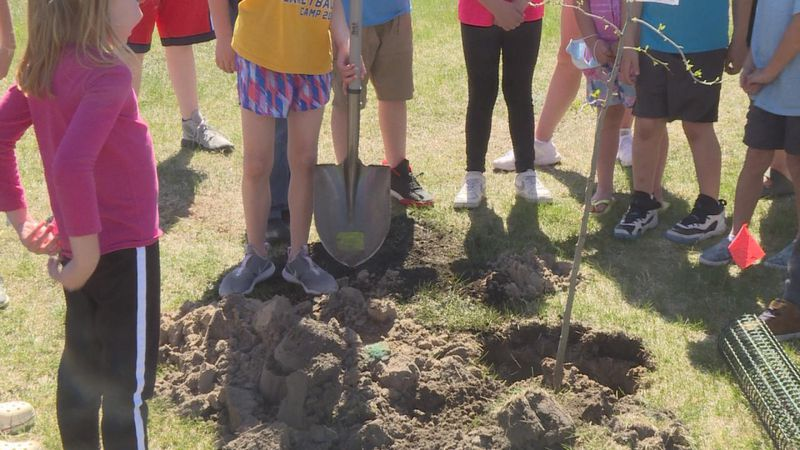 Students from Eisenhower elementary Kids Klub assisting the North Platte Public School...