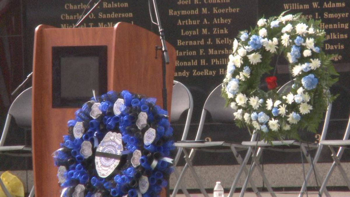 Two wreaths sit in front of the podium during the Nebraska Law Enforcement Memorial ceremony in...