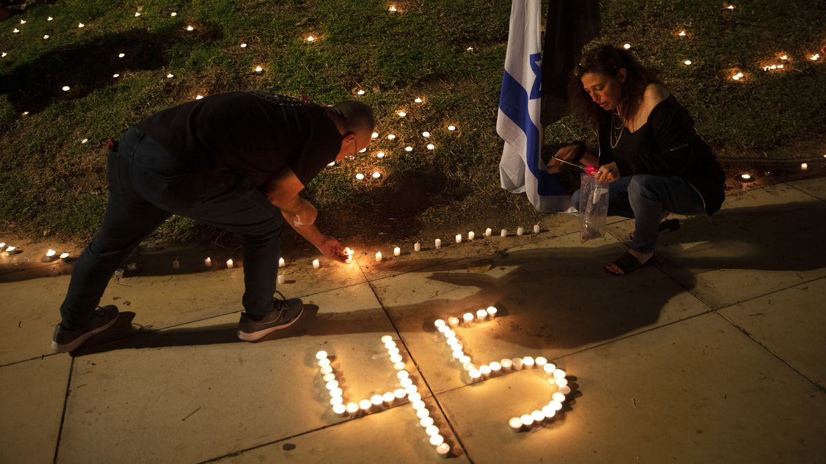 People lit candles in memory of the 45 ultra-Orthodox Jews killed in a stampede at a religious...