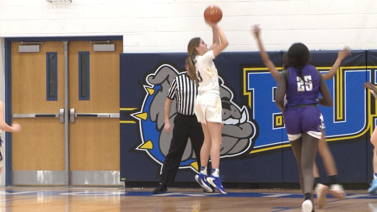 North Platte junior Abby Orr hits a jump shot over a defender in the Bulldogs' 64-48 win over Omaha Central. (Credit: Sam Pirozzi/KNOP-TV)