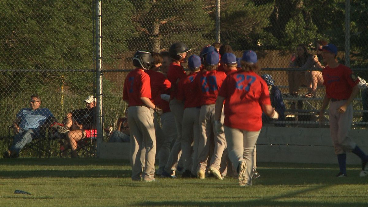The Hershland Trojans celebrate at home plate following their walk-off win in extra innings on Tuesday. (Credit: Patrick Johnstone/KNOP-TV)