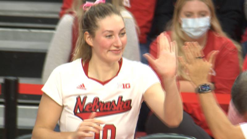 Nebraska volleyball player give a teammate a high five during the Huskers' sweep over Indiana.