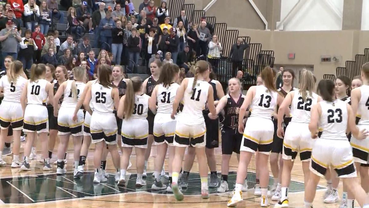 Mullen and BDS girls' basketball shake hands prior to their round one game in the State tournament. (Credit: Sam Pirozzi/KNOP-TV)