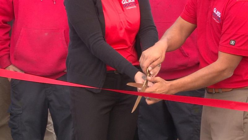 Ribbon cutting event for new business in community