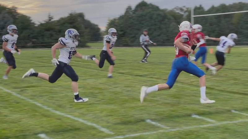 Medicine Valley player running into the end zone for a touchdown.