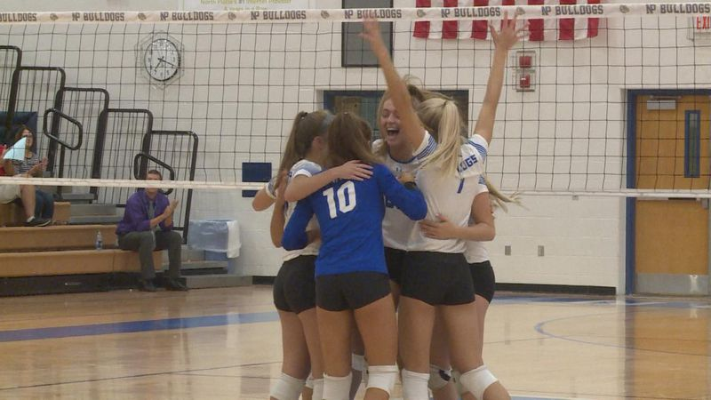 The North Platte volleyball team celebrates a point in their 3-1 victory over Grand Island...