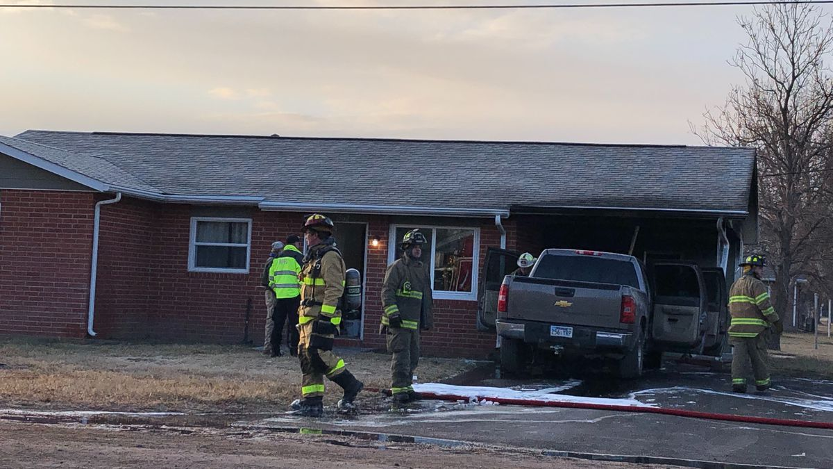 A North Platte mom returns home after dropping her oldest child at school to discover the carport on fire.  Sara Murphy says the flames destroyed some of the house too.   (SOURCE: Erika Siebring/KNOP-TV)