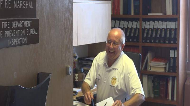 Fire Marshall George Lewis laughing in his office on July 22, 2021.
