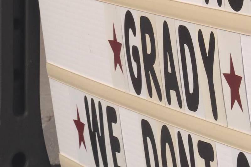 Signs for Grady Simants, a North Platte boy battling brain cancer.