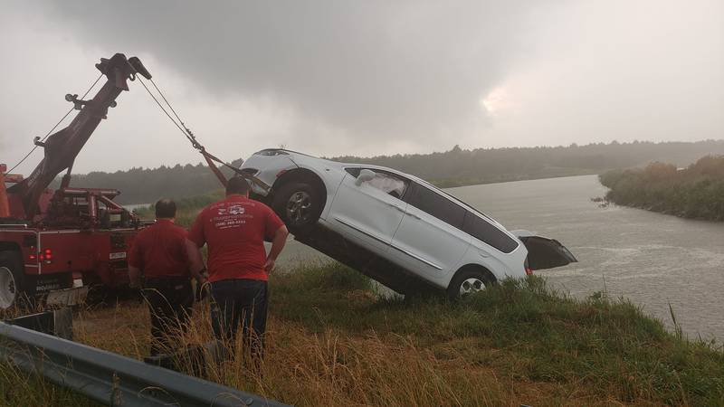 Lincoln County Dive Team helps remove minivan from canal.